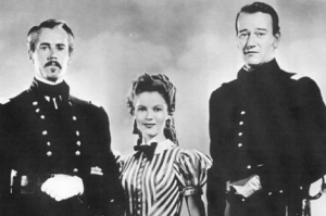 "With Henry Fonda and The Dook in ""Fort Apache"", one of Temple's last movies.  She was about 19 or 20.  Yow."